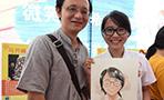初の「中国医師節」に入院患者たちの似顔絵描く